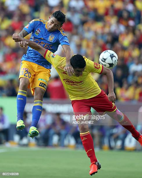 David Cabrera of Morelia vies for the ball with Javier Aquino of Tigres during their Mexican Apertura 2016 tournament football match at the Jose...