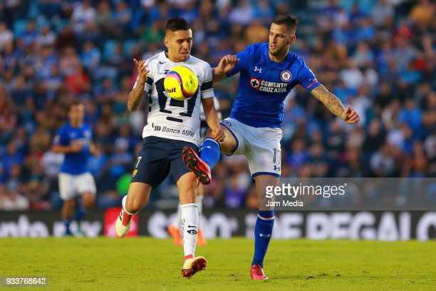 David Cabrera of Pumas fights for the ball with Edgar Mendez of Cruz Azul during the 12th round match between Cruz Azul and Pumas UNAM as part of the...