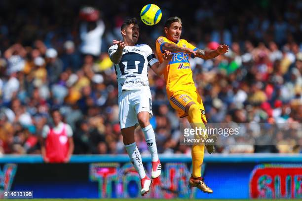 David Cabrera of Pumas heads for the ball with Ismael Sosa of Tigres during the 5th round match between Pumas UNAM and Tigres UANL as part of the...