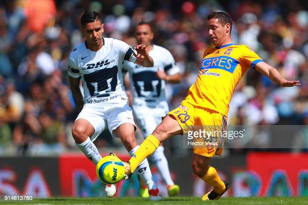 David Cabrera of Pumas struggles for the ball with Jesus Dueñas of Tigres during the 5th round match between Pumas UNAM and Tigres UANL as part of...