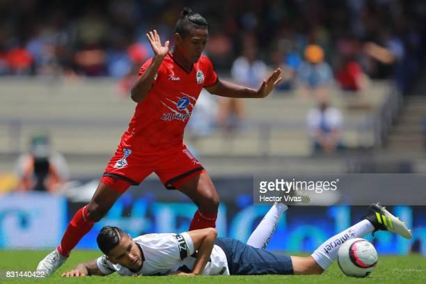 David Cabrera of Pumas struggles for the ball with Pedro Aquino of Lobos BUAP during the fourth round match between Pumas UNAM and Lobos BUAP as part...