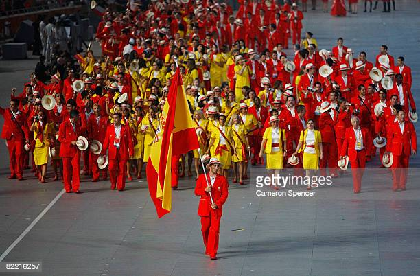 David Cal of the Spain Olympic canoe/kayak team carries his country's flag to lead out the delegation during the Opening Ceremony for the 2008...
