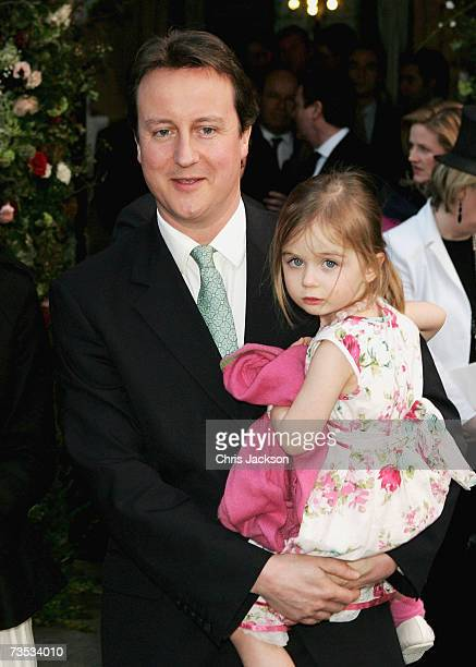 David Cameron and his daughter Nancy leave Christ Church after attending the wedding of Alan Parker and Jane Hardman on March 9 2007 in London...