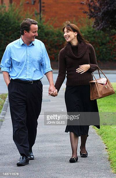 David Cameron arrives at a reading class in Dewsbury with his wife Samantha 02 October 2005 and suggested he was the only Tory leadership candidate...