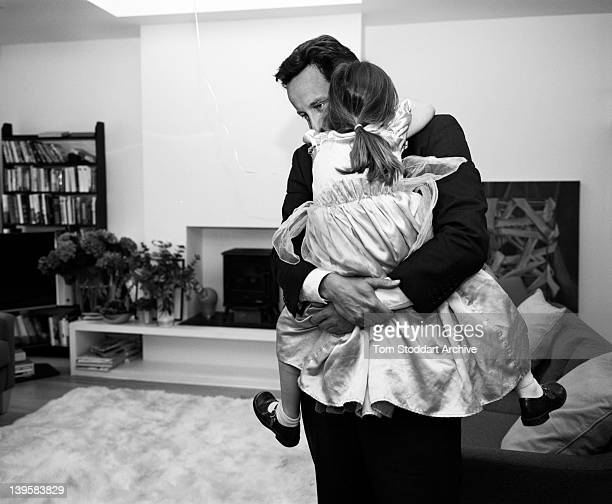 David Cameron is embraced by his daughter Nancy on his return home to London after a long day travelling around Cornwall England