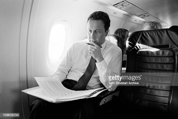 David Cameron, Leader of Britain's Conservative Party photographed deep in thought aboard a plane during his campaign to become British Prime...