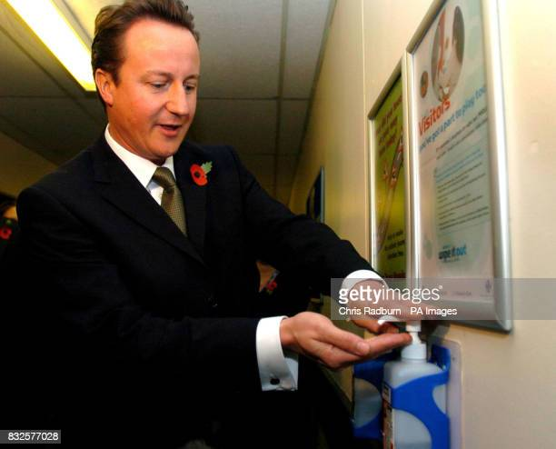 David Cameron leader of the Conservative Party washes his hands using an alcohol gel as he arrives at the Ipswich Hospital Ipswich Suffolk
