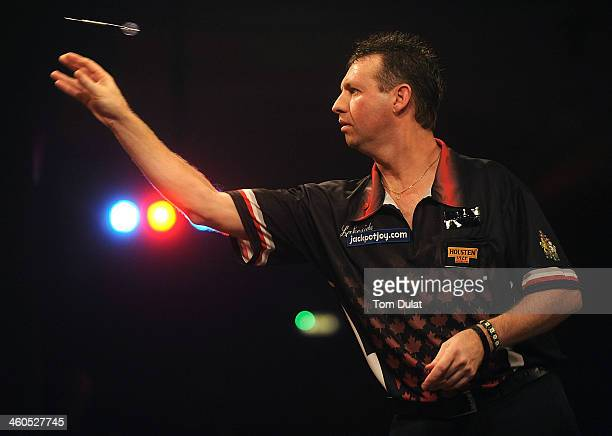 David Cameron of Canada in action against Martin Adams of England on day one of the BDO Lakeside World Professional Darts Championships at Lakeside...