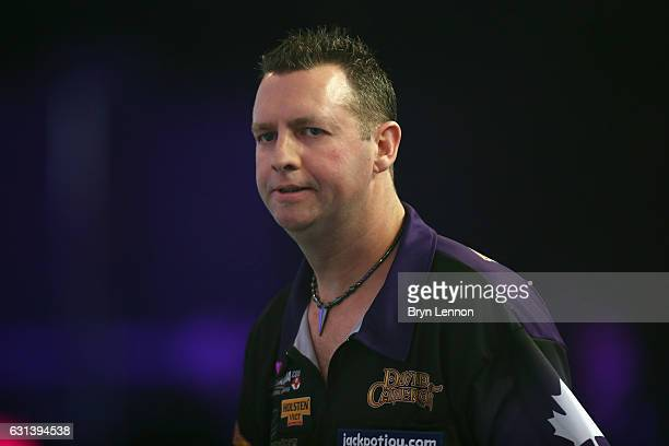 David Cameron of Canada looks on during his first round match on day four of the BDO Lakeside World Professional Darts Championships on January 10...