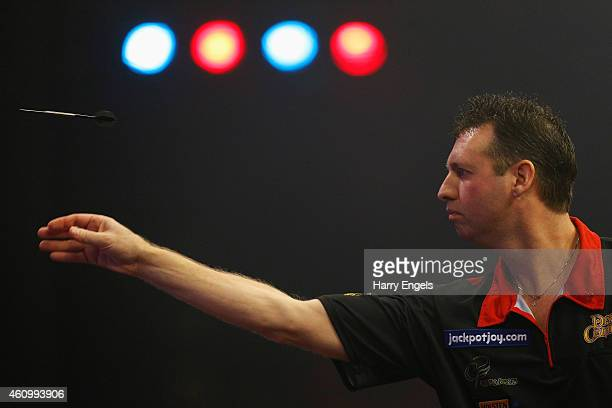 David Cameron of Canada throws during his Preliminary Round match against Michel Van Der Horst of the Netherlands on day one of the BDO Lakeside...