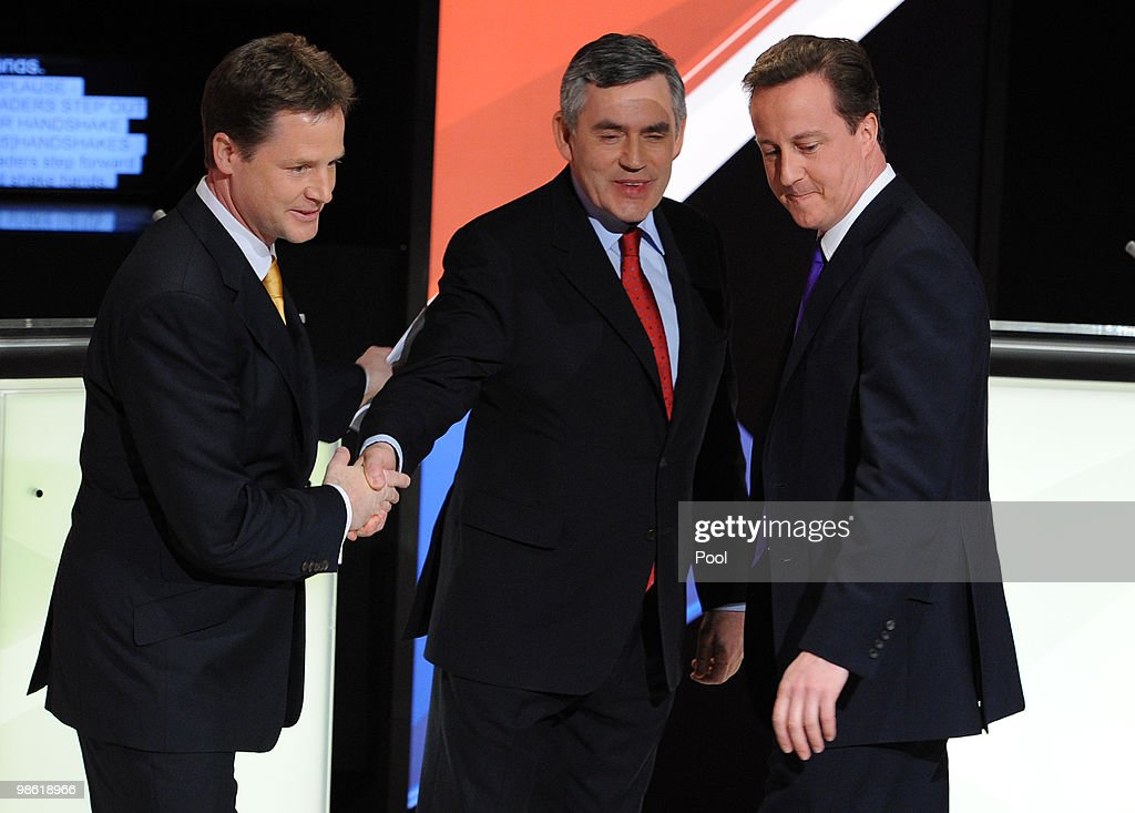 David Cameron (R) of the Conservative Party and Nick Clegg (L) of the Liberal Democrats Party and Gordon Brown (C) of the Labour Party, shake hands after the live second televised election debate on April 15, 2010 in Bristol, United Kingdom. Britain for the first time is televising three political debates live, reminiscent of the U.S. style of debates. The second of the three planned election debates, focuses on global affairs, airing live on Sky News from 20:00 BST.
