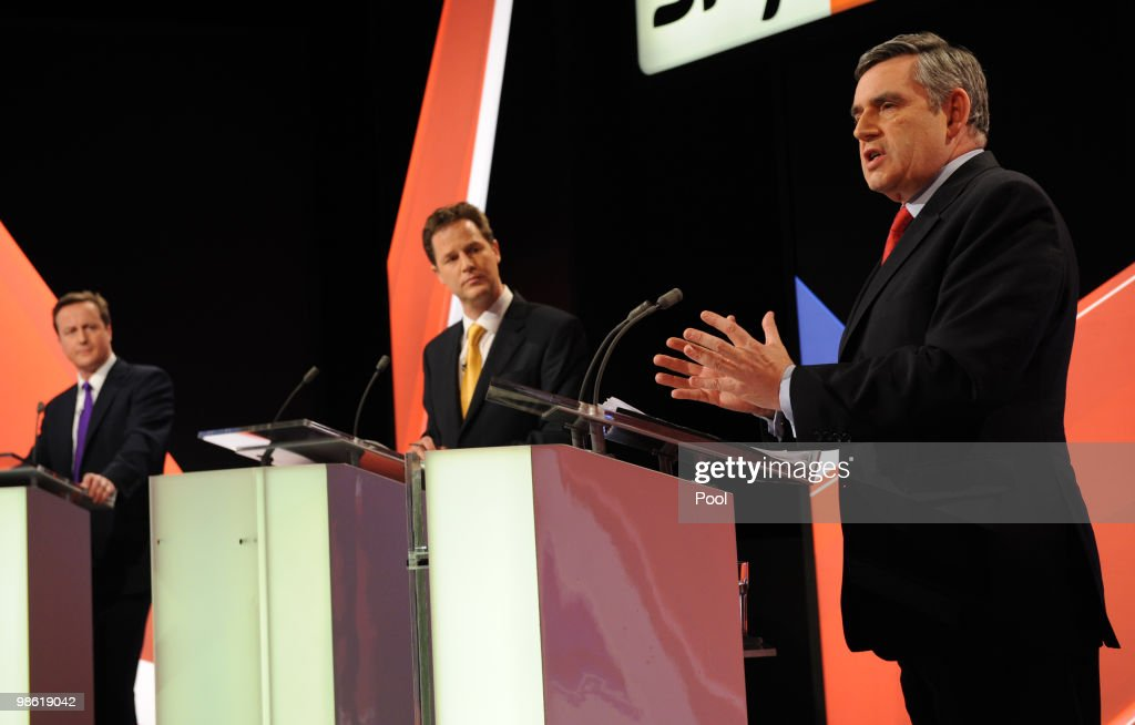 David Cameron (L) of the Conservative Party and Nick Clegg (C) of the Liberal Democrats Party listen to Gordon Brown (R) of the Labour Party speak during the live second televised election debate on April 15, 2010 in Bristol, United Kingdom. Britain for the first time is televising three political debates live, reminiscent of the U.S. style of debates. The second of the three planned election debates, focuses on global affairs, airing live on Sky News from 20:00 BST.