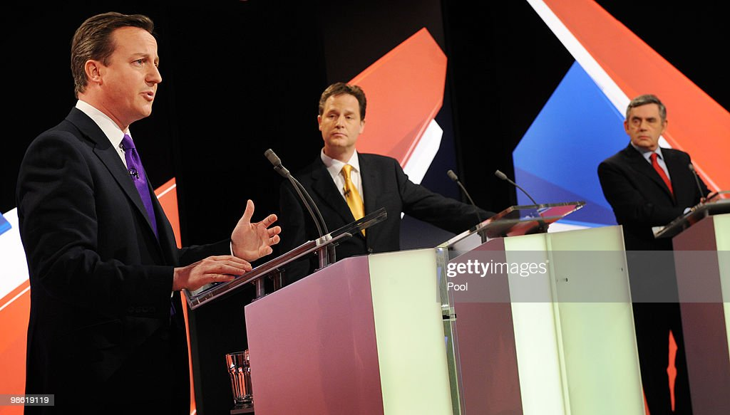 David Cameron (L) of the Conservative Party speaks and Nick Clegg (C) of the Liberal Democrats Party and Gordon Brown (R) of the Labour Party listen during the live second televised election debate on April 15, 2010 in Bristol, United Kingdom. Britain for the first time is televising three political debates live, reminiscent of the U.S. style of debates. The second of the three planned election debates, focuses on global affairs, airing live on Sky News from 20:00 BST.