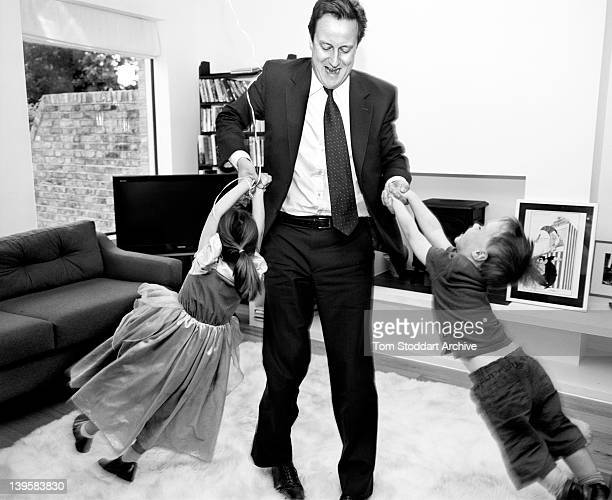 David Cameron playing with his children Arthur and Nancy at their London home