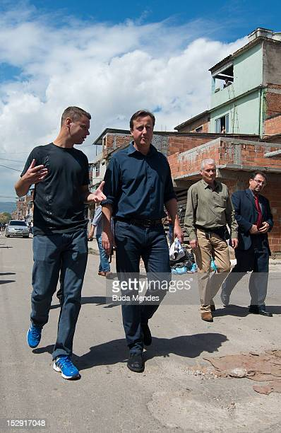 David Cameron Prime Minister of Great Britain during an official visit to Luta Pela Peaz Project at Complexo da Mare on September 28 2012 in Rio De...