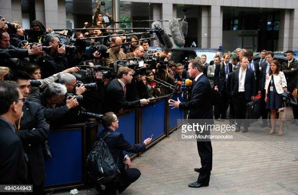 David Cameron Prime Minister of the United Kingdom speaks to the media as he arrives for the Informal Dinner of Heads of State or Government held at...