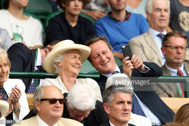 David Cameron takes a photo from the centre court royal box on day ten of the Wimbledon Lawn Tennis Championships at the All England Lawn Tennis and...