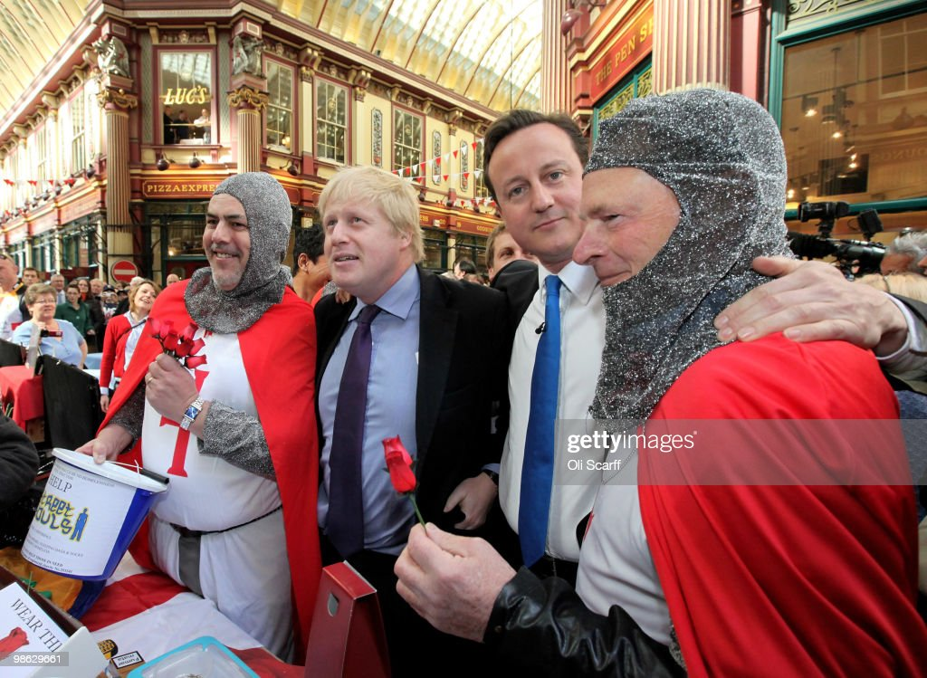 David Cameron (2nd R), the leader of the Conservative party, and Boris Johnson (2nd L), the Mayor of London, tour Leadenhall Market on St George's Day on April 23, 2010 in London, England. Addressing a crowd in the market Mr Cameron said he wanted to reclaim the English flag from the British National Party who are due to launch their election manifesto today.