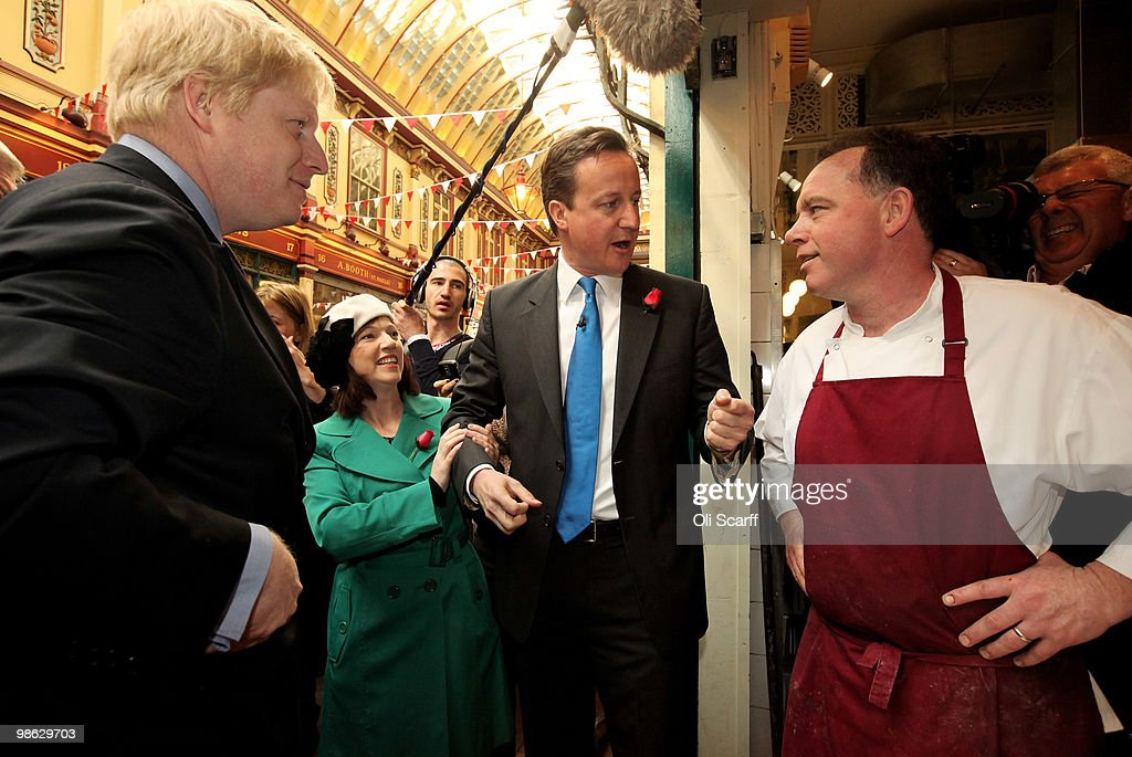 David Cameron (c), the leader of the Conservative party, and Boris Johnson (l), the Mayor of London, tour Leadenhall Market on St George's Day on April 23, 2010 in London, England. Addressing a crowd in the market Mr Cameron said he wanted to reclaim the English flag from the British National Party who are due to launch their election manifesto today.