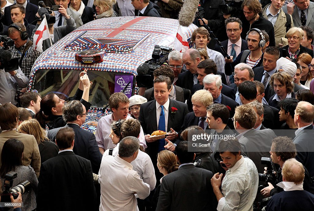 David Cameron (c), the leader of the Conservative party, and Boris Johnson, the Mayor of London, tour Leadenhall Market on St George's Day on April 23, 2010 in London, England. Addressing a crowd in the market Mr Cameron said he wanted to reclaim the English flag from the British National Party who are due to launch their election manifesto today.