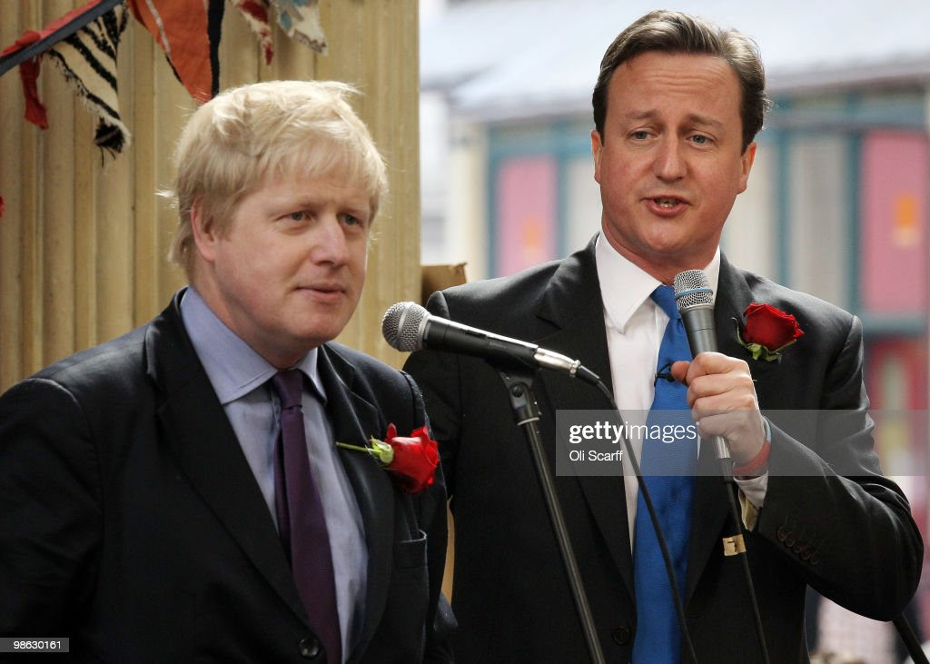 David Cameron (r), the leader of the Conservative party, and Boris Johnson, the Mayor of London, address the crowd as they tour Leadenhall Market on St George's Day on April 23, 2010 in London, England. Addressing a crowd in the market Mr Cameron said he wanted to reclaim the English flag from the British National Party who are due to launch their election manifesto today.