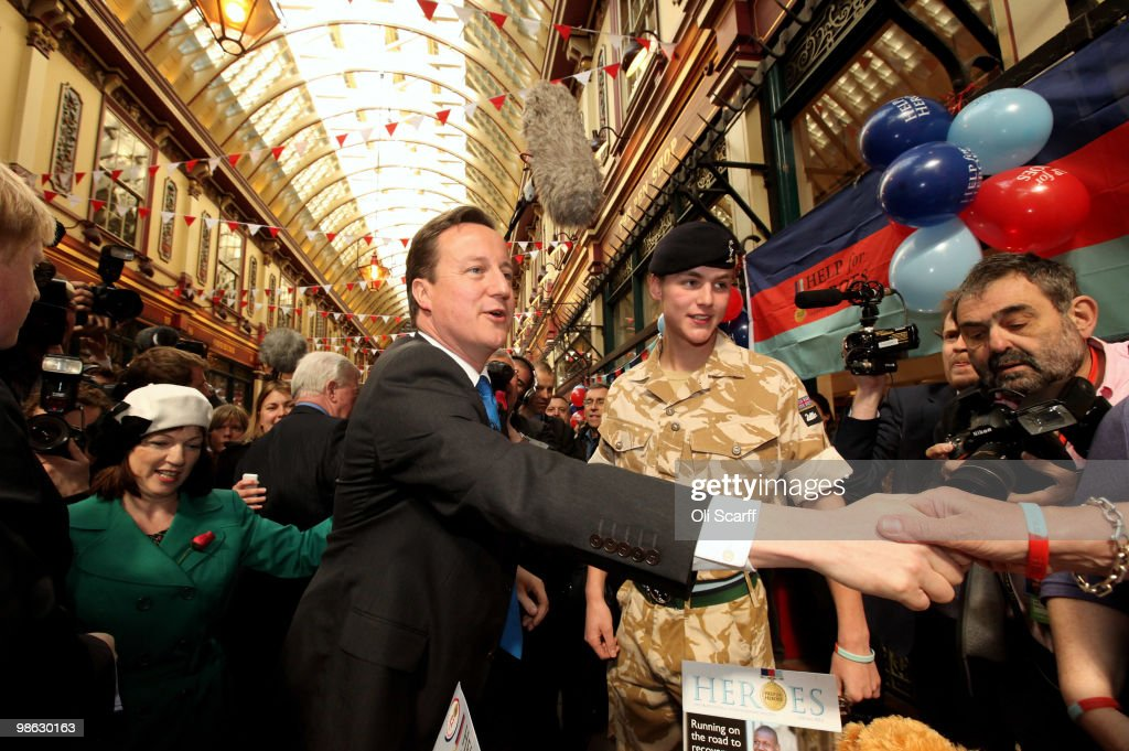 David Cameron (c), the leader of the Conservative party, tours Leadenhall Market on St George's Day on April 23, 2010 in London, England. Addressing a crowd in the market Mr Cameron said he wanted to reclaim the English flag from the British National Party who are due to launch their election manifesto today.