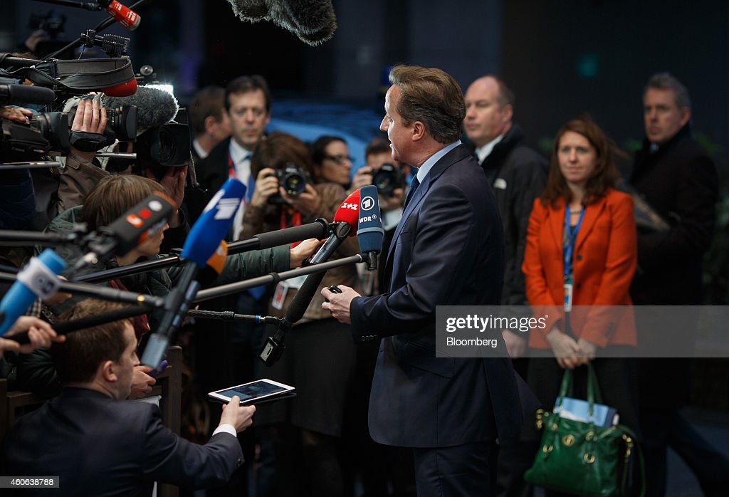 David Cameron, U.K. prime minister, center, arrives for a European Union (EU) summit meeting in Brussels, Belgium, on Thursday, Dec. 18, 2014. The EU outlawed the sale of some energy-exploration equipment to Crimea, seeking to prevent Russia from using the newly annexed Ukrainian peninsula to exploit Black Sea oil and gas deposits. Photographer: Jasper Juinen/Bloomberg via Getty Images