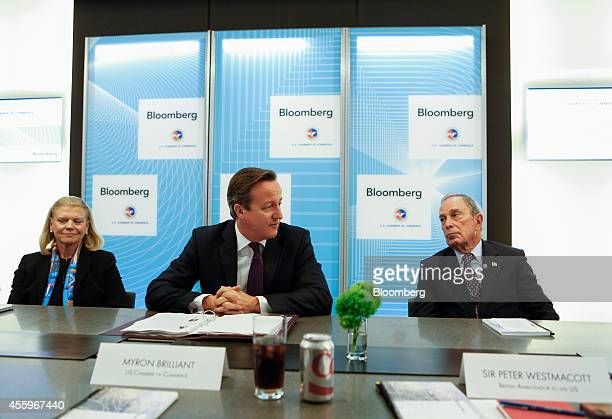 David Cameron UK prime minister center speaks during a CEO Roundtable with Michael 'Mike' Bloomberg founder of Bloomberg LP right and Ginni Rometty...