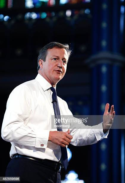 David Cameron UK prime minister gestures as he speaks to the audience after removing his suit jacket during the Commonwealth Games Business...