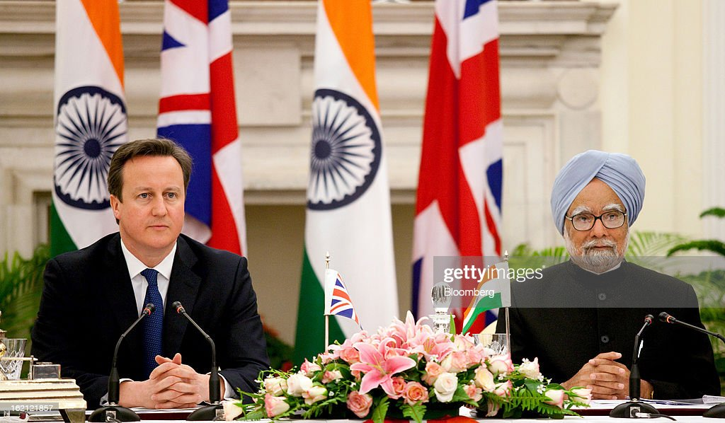 David Cameron, U.K. prime minister, left, and Manmohan Singh, India's prime minister, attend a news conference at Hyderabad House in New Delhi, India, on Tuesday, Feb. 19, 2013. Cameron said he wants to see rapid progress on a European Union-India free trade agreement as a way of boosting economic growth. Photographer: Graham Crouch/Bloomberg via Getty Images
