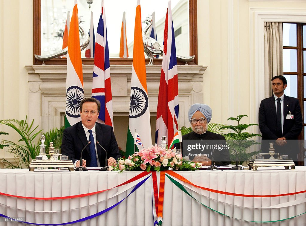 David Cameron, U.K. prime minister, left, speaks while Manmohan Singh, India's prime minister, listens during a news conference at Hyderabad House in New Delhi, India, on Tuesday, Feb. 19, 2013. Cameron said he wants to see rapid progress on a European Union-India free trade agreement as a way of boosting economic growth. Photographer: Graham Crouch/Bloomberg via Getty Images