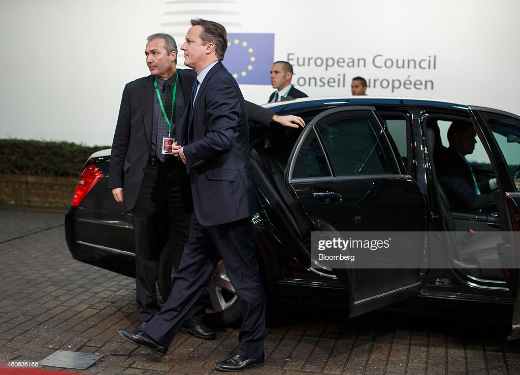 David Cameron, U.K. prime minister, second left, arrives for a European Union (EU) summit meeting in Brussels, Belgium, on Thursday, Dec. 18, 2014. The EU outlawed the sale of some energy-exploration equipment to Crimea, seeking to prevent Russia from using the newly annexed Ukrainian peninsula to exploit Black Sea oil and gas deposits. Photographer: Jasper Juinen/Bloomberg via Getty Images