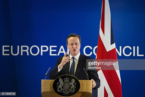 David Cameron UK prime minister speaks during a news conference following a meeting of European Union leaders in Brussels Belgium on Friday Feb 19...