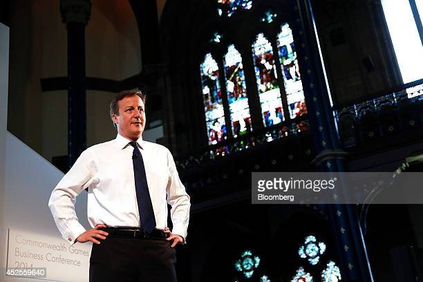 David Cameron UK prime minister speaks to the audience after removing his suit jacket during the Commonwealth Games Business Conference in Glasgow UK...