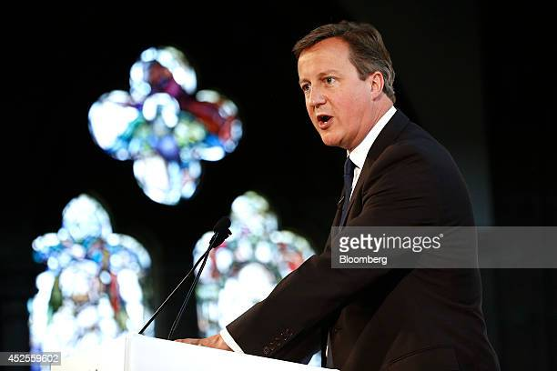 David Cameron UK prime minister stands at the podium and speaks during the Commonwealth Games Business Conference in Glasgow UK on Wednesday July 23...