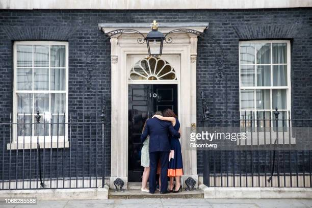David Cameron UK's outgoing prime minister and his wife Samantha Cameron embrace with their children Nancy Elwen and Florence outside 10 Downing...