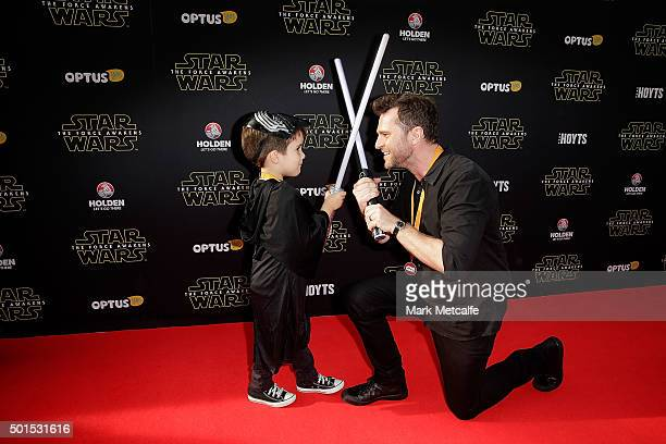 David Campbell and his son Leo arrive ahead of the 'Star Wars The Force Awakens' Australian premiere on December 16 2015 in Sydney Australia