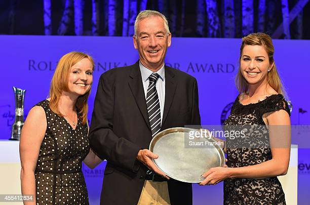 David Cannon of Getty Images recieves The Rolex Lifetime Achievment award from Paula Creamer of USA and Kelly Thesier LPGA Director of Communications...