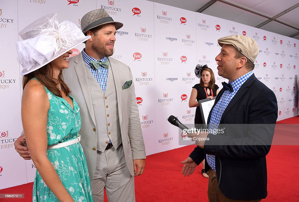 David Caplan, journalist for gossipdavid.com, interviews David Denman (center) and Mercedes Masohn on the red carpet at the 139th Kentucky Derby at Churchill Downs on May 4, 2013 in Louisville, Kentucky.