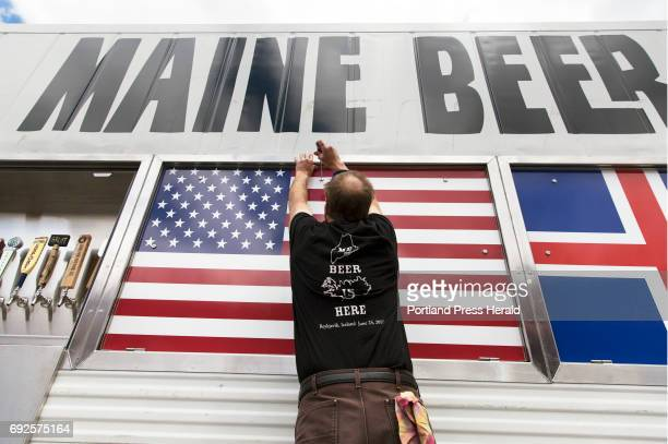 David Carlson owner of Marshall Wharf Brewing Co opens panels in the Maine Beer Box a customfabricated shipping container that is bound for a beer...