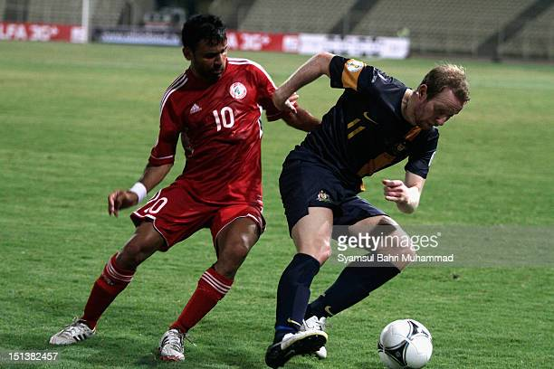 David Carney of Australia controls the ball from Abbas Atwi of Lebanon during the International Friendly match between Lebanon and the Australian...