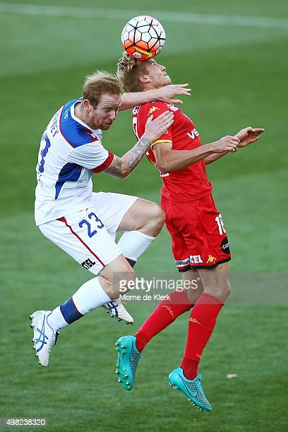 David Carney of Newcastle Jets competes with James Jeggo of Adelaide United during the round seven ALeague match between Adelaide United and the...