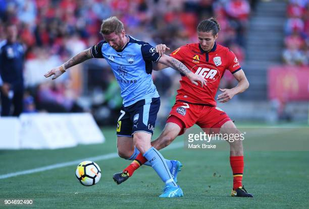 David Carney of Sydney FC and Michael Marrone of Adelaide United compete during the round 16 ALeague match between Adelaide United and Sydney FC at...