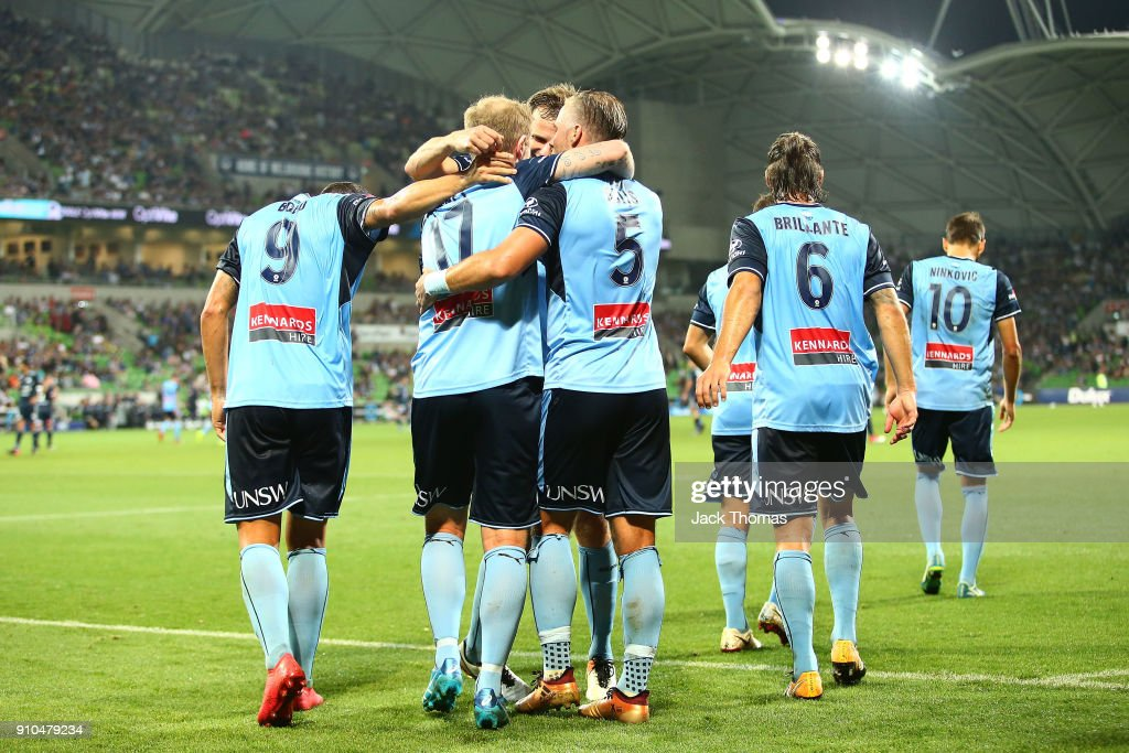 David Carney of Sydney FC celebrates a goal with team mates during the round 18 A-League match between Melbourne Victory and Sydney FC at AAMI Park on January 26, 2018 in Melbourne, Australia.