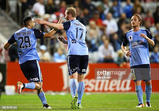 David Carney of Sydney FC celebrates his goal with team mates during the FFA Cup round of 32 match between the Wollongong Wolves and Sydney FC at WIN...