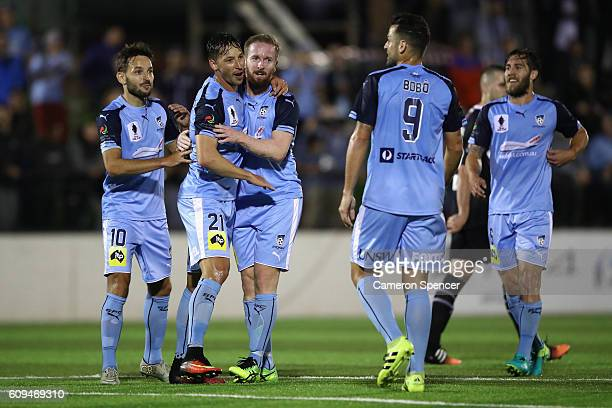 David Carney of Sydney FC celebrates with his team mates after scoring a goal during the FFA Cup Quarter Final between Blacktown and Sydney FC on...
