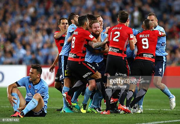 David Carney of Sydney FC clashes with Scott Neville of the Wanderers after Robbie Cornthwaite of the Wanderers tackled Bobo of Sydney FC during the...