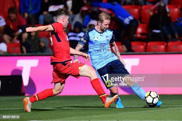 David Carney of Sydney FC gets the cross in during the round nine ALeague match between the Adelaide 36ers and the Sydney Kings at Coopers Stadium on...
