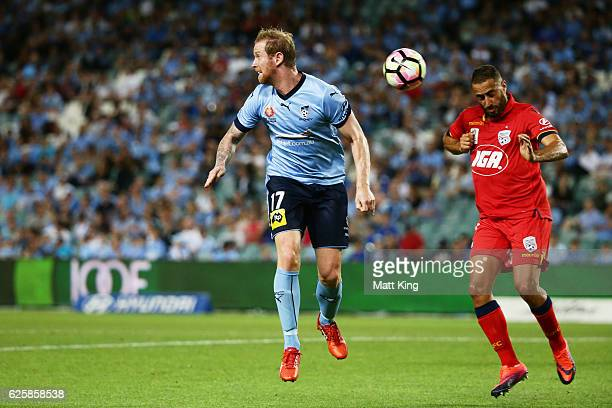 David Carney of Sydney FC heads the ball next to Tarek Elrich of United during the round eight ALeague match between Sydney FC and Adelaide United at...