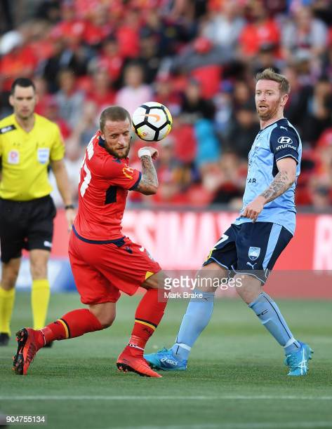 David Carney of Sydney FC kicks into Daniel Adlung of Adelaide United during the round 16 ALeague match between Adelaide United and Sydney FC at...
